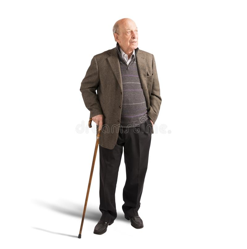 Elderly walking with stick stock photography