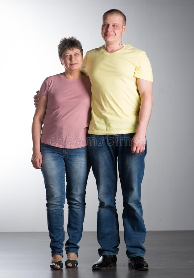 Elderly woman with adult son stock photos