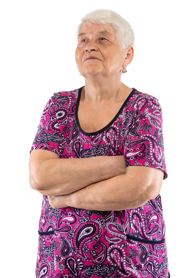 Elderly woman with arms crossed looking up. On white background royalty free stock photos