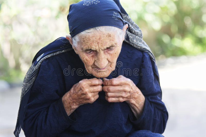 Download Elderly Woman Buttoning Dress Up Stock Image - Image: 15474143