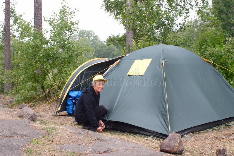 Elderly woman in camping royalty free stock photos