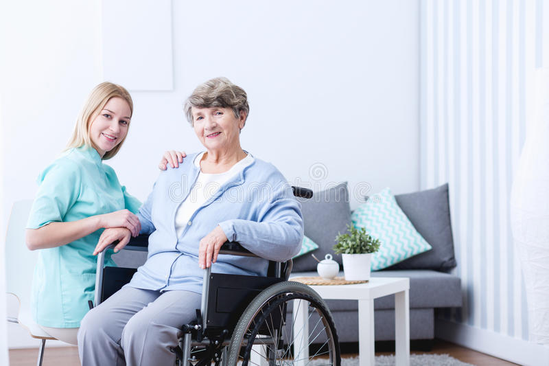Elderly woman and caregiver royalty free stock photos