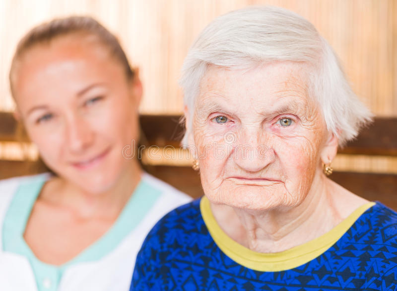 Elderly woman with caregiver. Photo of elderly women with her caregiver royalty free stock photos