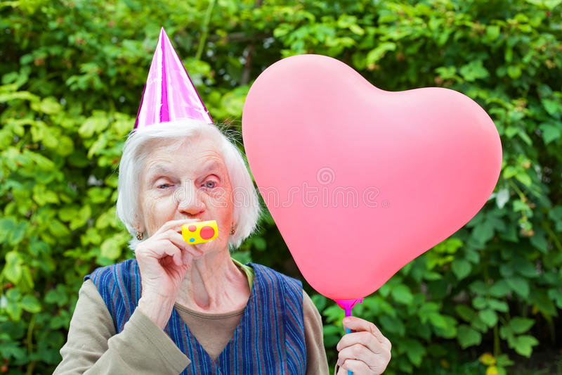 Elderly woman celebrating birthday stock photos