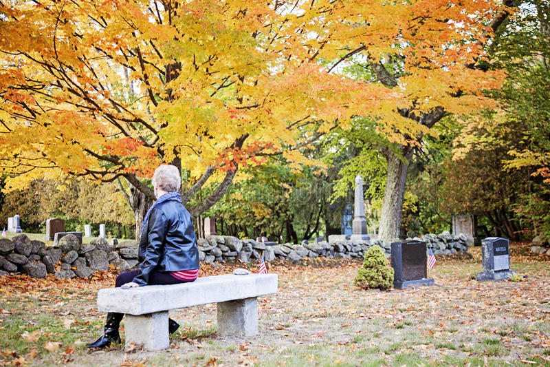 Elderly woman in cemetery royalty free stock photos