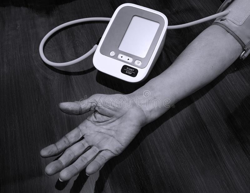 Elderly woman check blood pressure.and heart rate with digital pressure measuring. Black and white tone. Happy aging and Medical. Concept royalty free stock photos