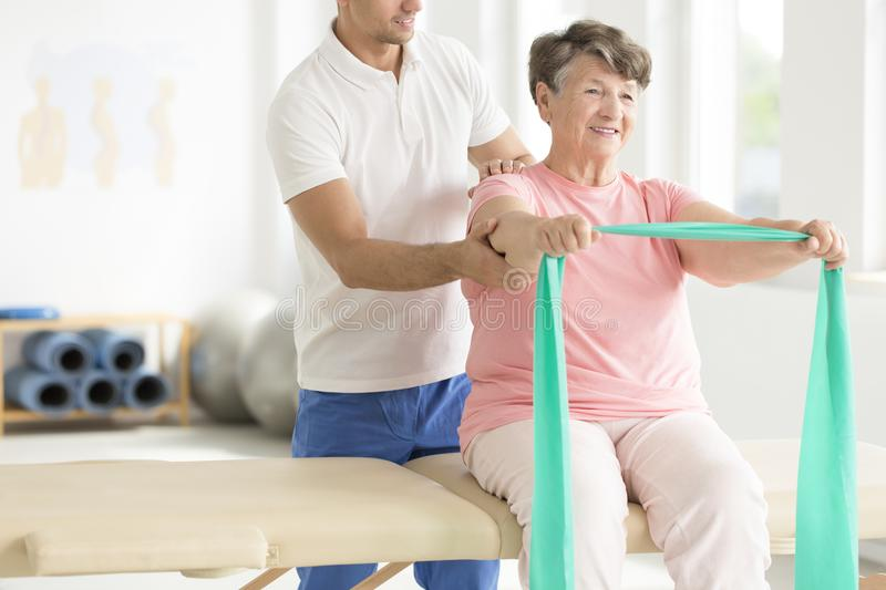Elderly woman doing exercises stock images