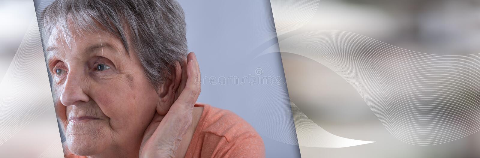 Elderly woman with earing problem. panoramic banner. Elderly woman having earing problem. panoramic banner stock photography