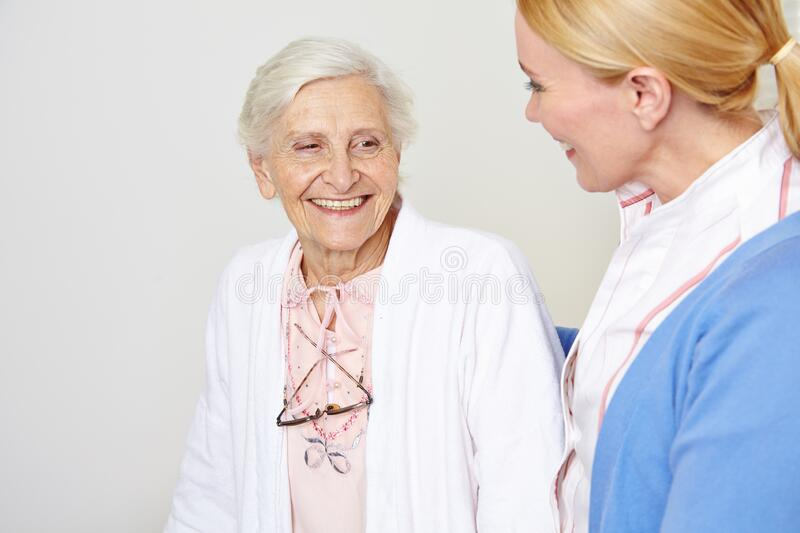 Elderly woman with elderly care in the nursing home stock photography