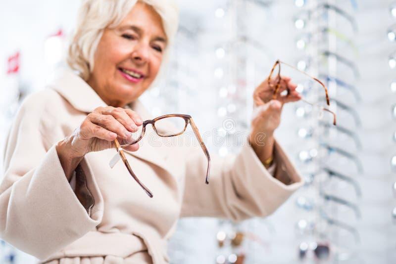 Elderly woman with eyesight problem stock photography