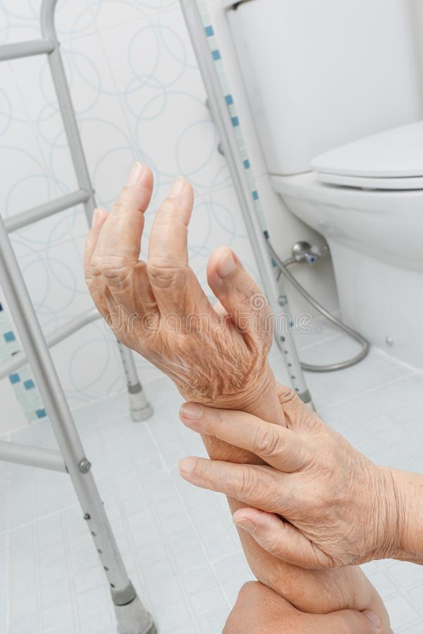 Elderly woman falling in bathroom stock image