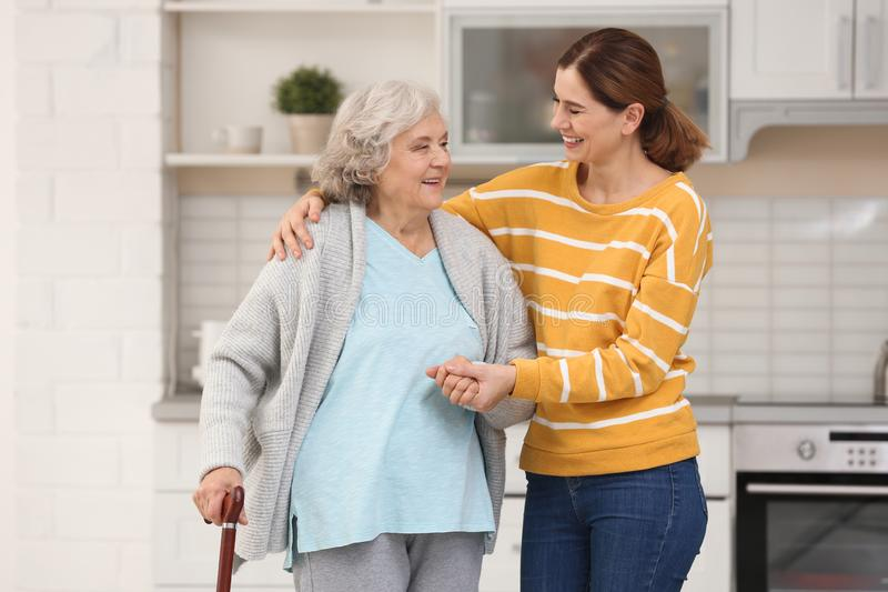 Elderly woman with female caregiver royalty free stock image