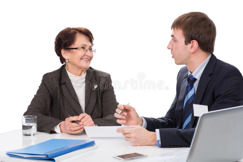 Elderly woman with a financial advisor stock image