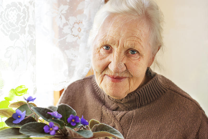 Elderly woman flower stock image