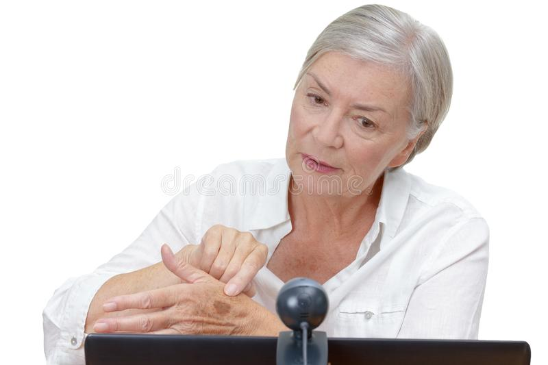 Senior woman computer webcam mole royalty free stock photo