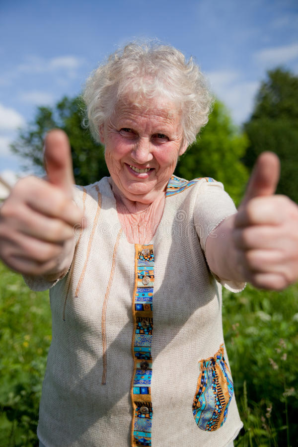 Elderly woman in a garden royalty free stock photography