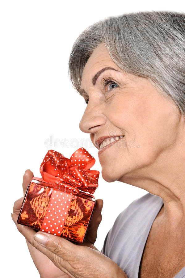 Elderly woman with gift stock photos