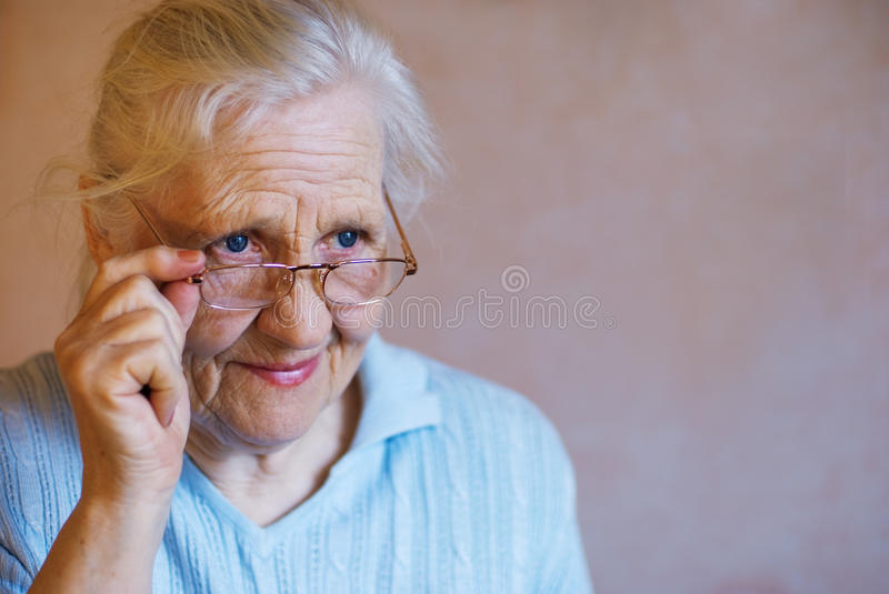 Elderly woman with glasses stock images