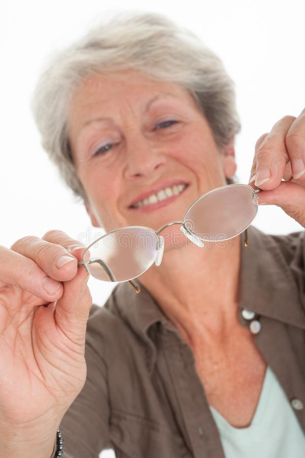 Elderly woman with glasses royalty free stock images