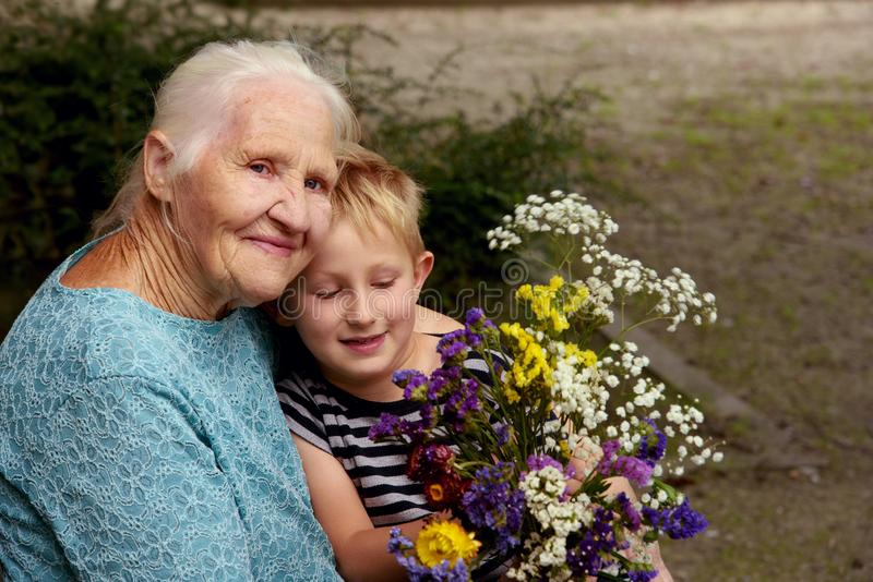 Elderly woman with grandson stock photography