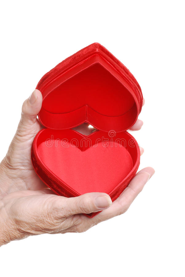 Download Elderly Woman Hands Holding An Open Red Heart Box Stock Photo - Image: 11258316