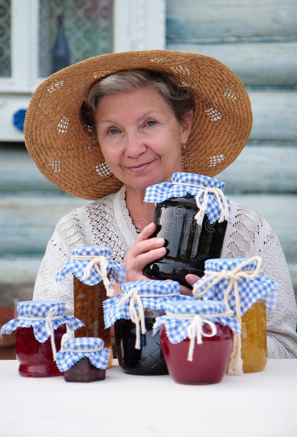 Download Elderly Woman Holding Jar Of Homemade Jam Royalty Free Stock Images - Image: 25719519