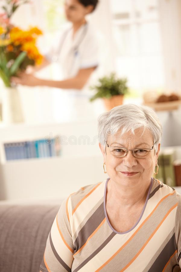 Elderly woman at home stock photos