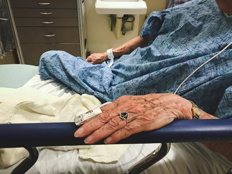Elderly woman in hospital bed as a patient stock photos