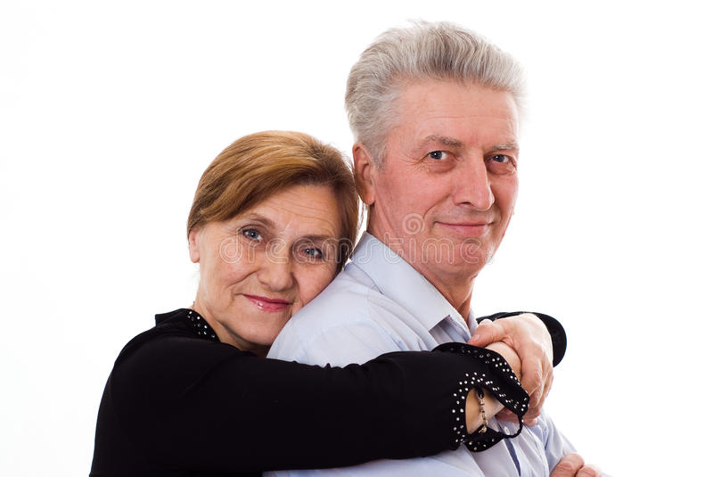 Elderly woman hugging a man on a white background stock images