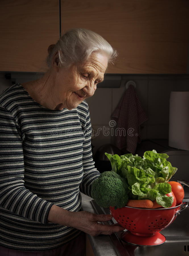 Elderly woman kitchen stock photo