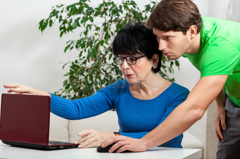 Elderly woman learning computer science royalty free stock photography