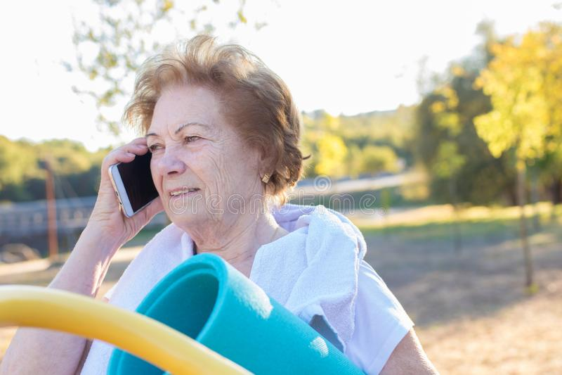 Elderly woman with mobile phone stock images