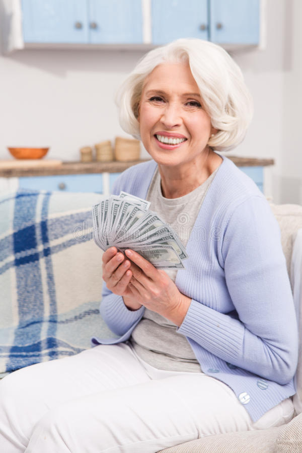 Elderly woman with money royalty free stock photography