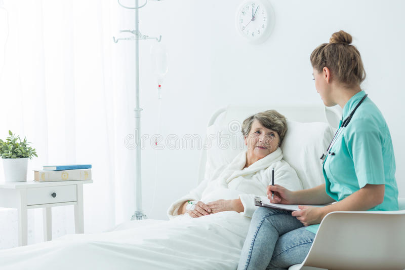 Elderly woman with nurse stock photography