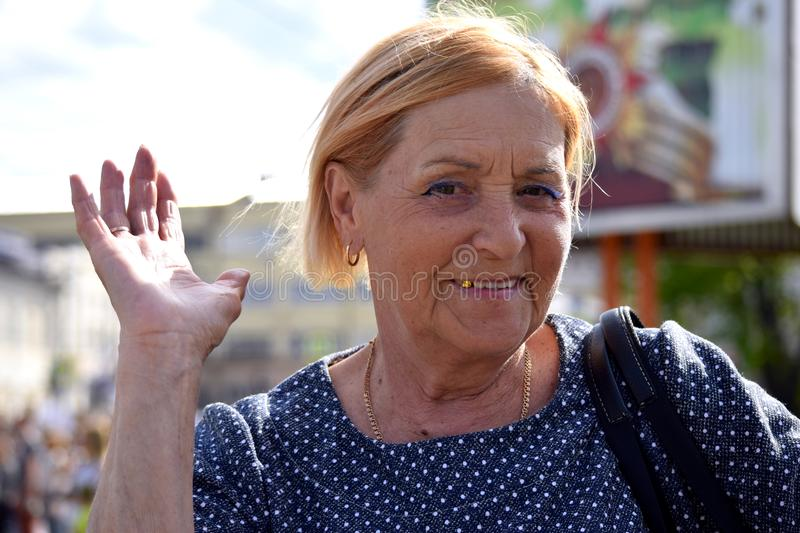 An elderly woman on the occasion of the Victory Day royalty free stock images