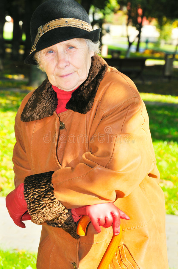 Elderly woman in park stock photos