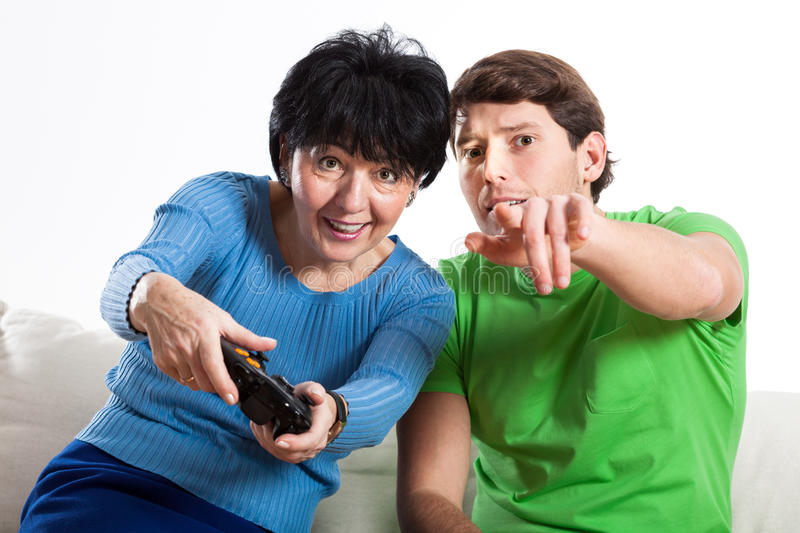 Elderly woman playing on console royalty free stock photos