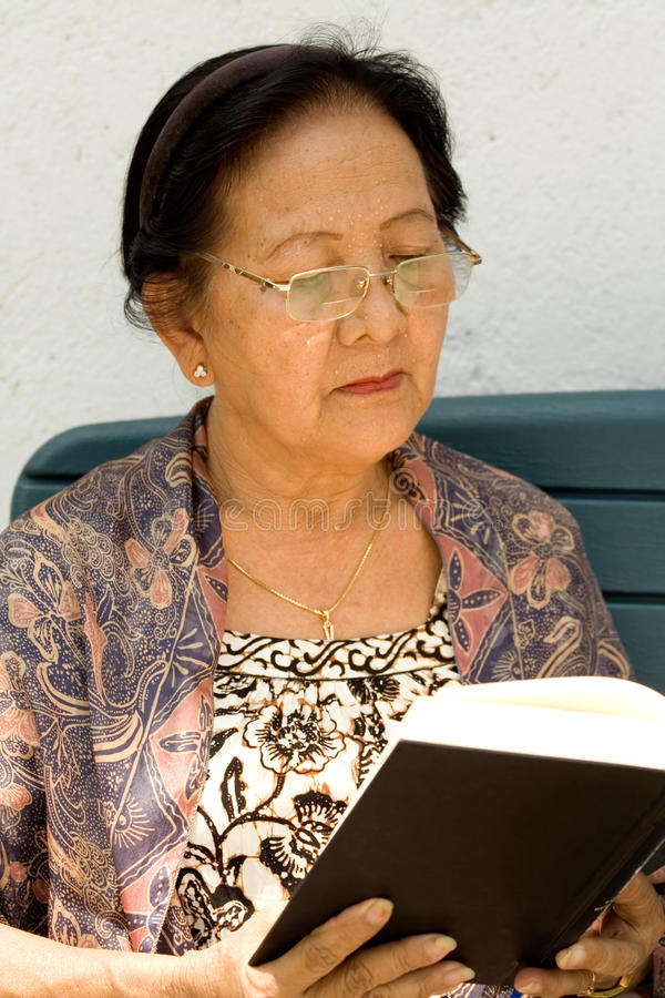 Elderly woman read book stock photography