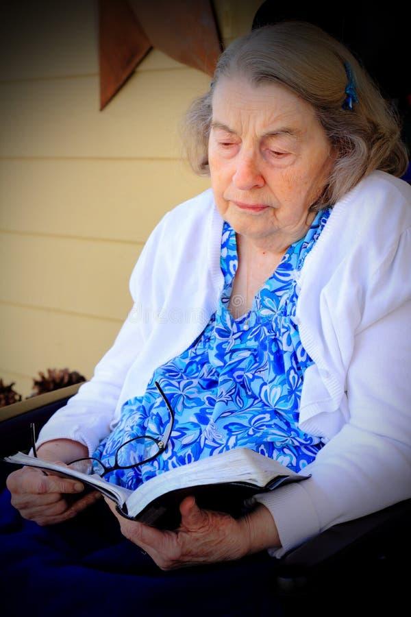 Elderly Woman Reading Bible royalty free stock image