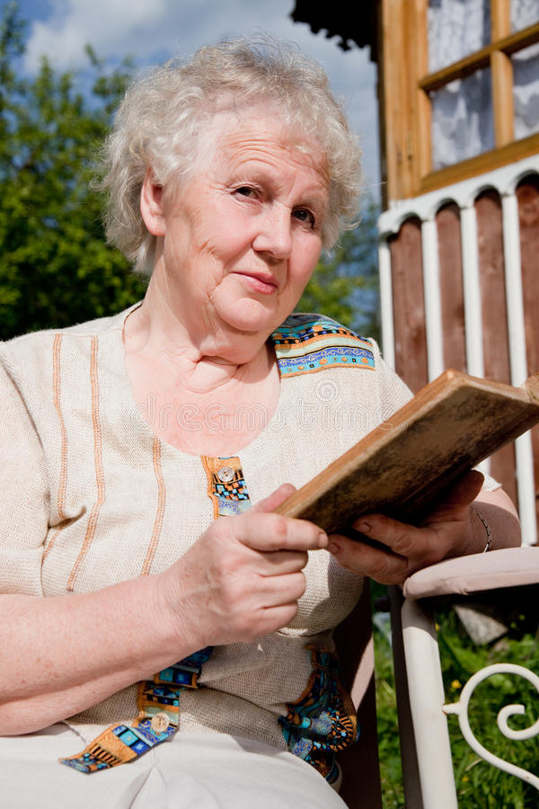 Download Elderly woman reads a book stock photo. Image of older - 17886338