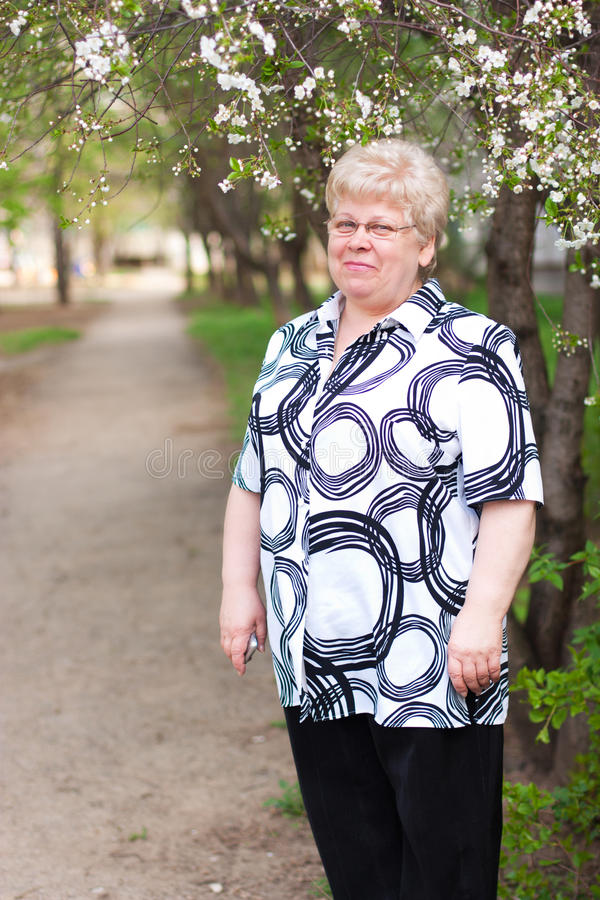 Download Elderly woman on the road stock image. Image of outdoors - 24491877