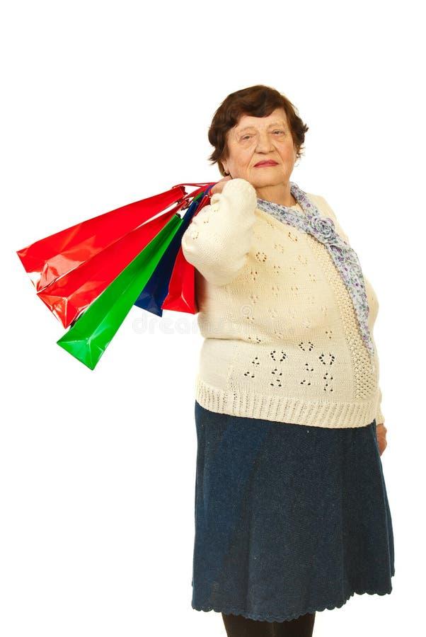 Elderly woman shopper stock photo