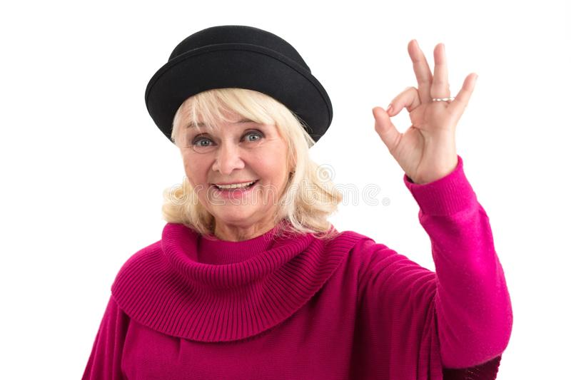 Elderly woman showing ok gesture. royalty free stock photos