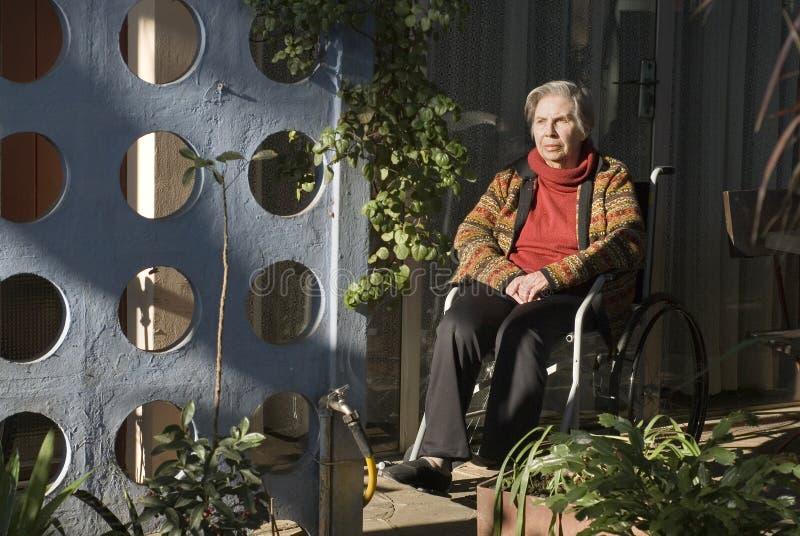 Elderly Woman Sitting in Wheelchair - Horizontal stock image