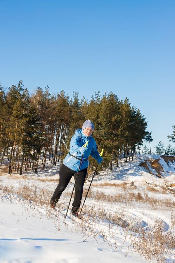 Elderly woman on ski walk stock photography