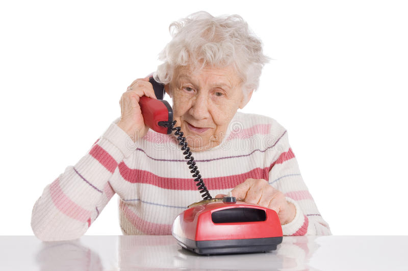 Elderly woman speaks on the phone royalty free stock photo