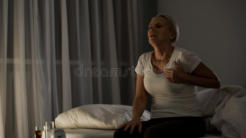 Elderly woman suffering from chest pain, heart attack, medical care, discomfort. Stock photo stock photography