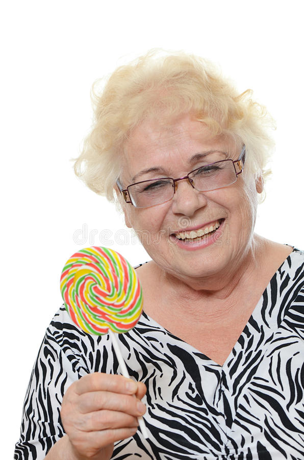 The elderly woman with sugar candy. The elderly woman with a sugar candy stock photography