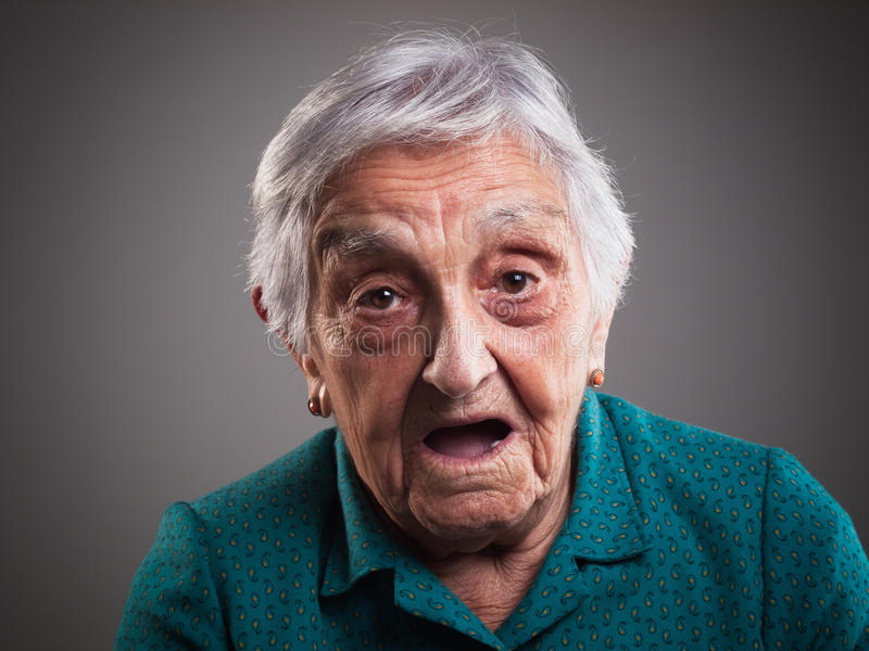 Elderly woman with surprised expression stock image