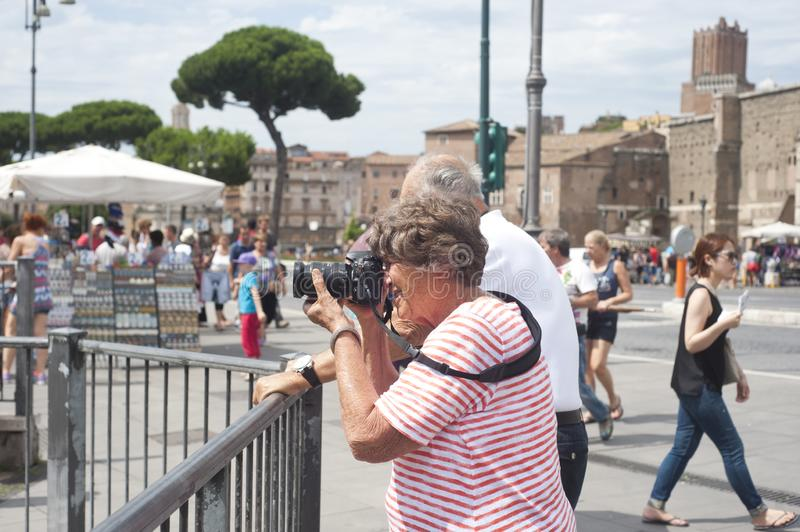 Elederly tourist couple taking photo in Rome, Italy royalty free stock photography